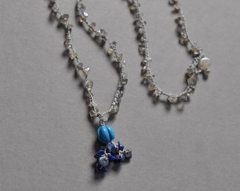 Crocheted gemstone fringe necklace in blues