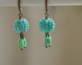 Tuquoise Globe festive dangle earrings
