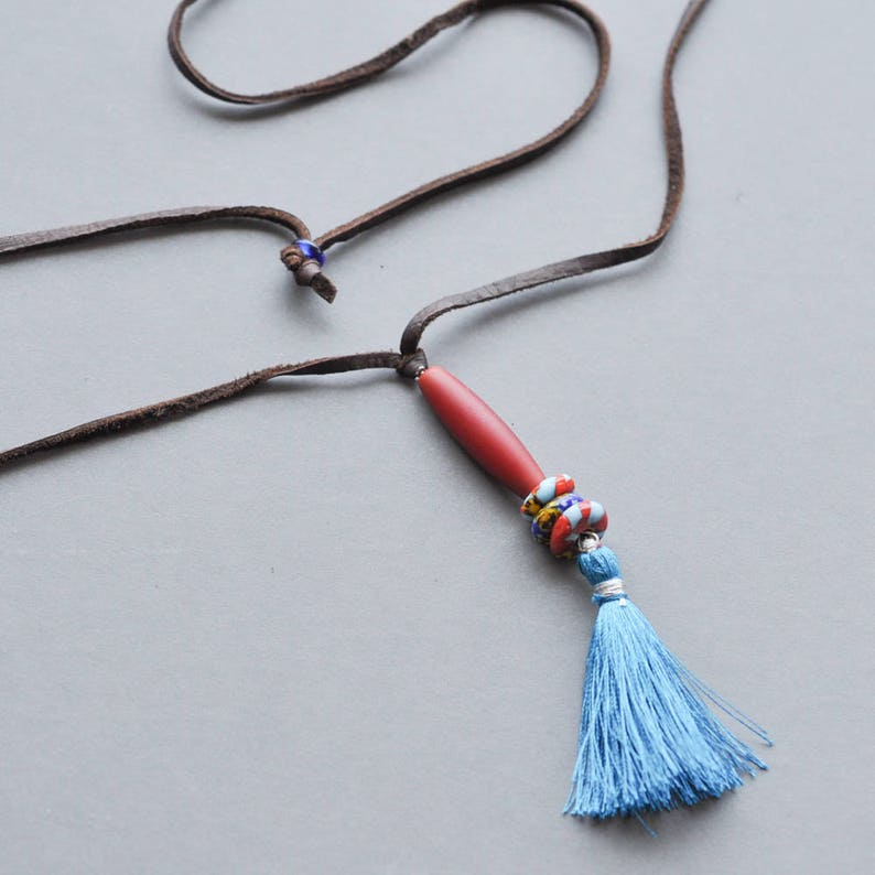 Adjustable soft leather cord with barrel bead and tassel