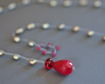Raspberry quartz drop lariat choker on a gray freshwater pearl strand with a ruby loop