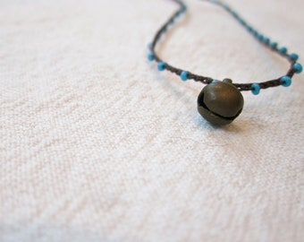 Tiny brass bell charm on daintiest crocheted beaded necklace with turquoise blue and brown strand
