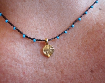 Mini Spiral Disk Charm on daintiest crocheted beaded necklace with turquoise blue and brown strand