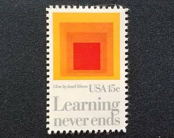 Ten (10) vintage unused postage stamps - Learning never ends // 15 cent stamps // face value 1.50