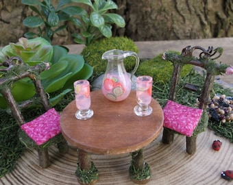 Miniature Glass Pitcher and two glasses of Pink Lemonade with strawberry and lime slices