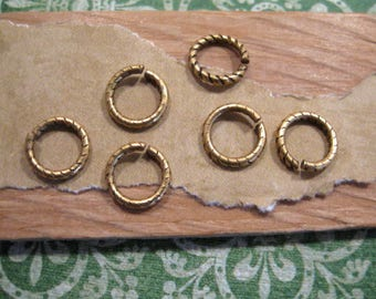 Jumprings 9 mm etched in Antique Gold from Nunn Design - 6 count
