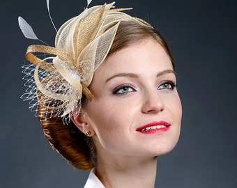Champagne and golden fascinator for your special occasions.