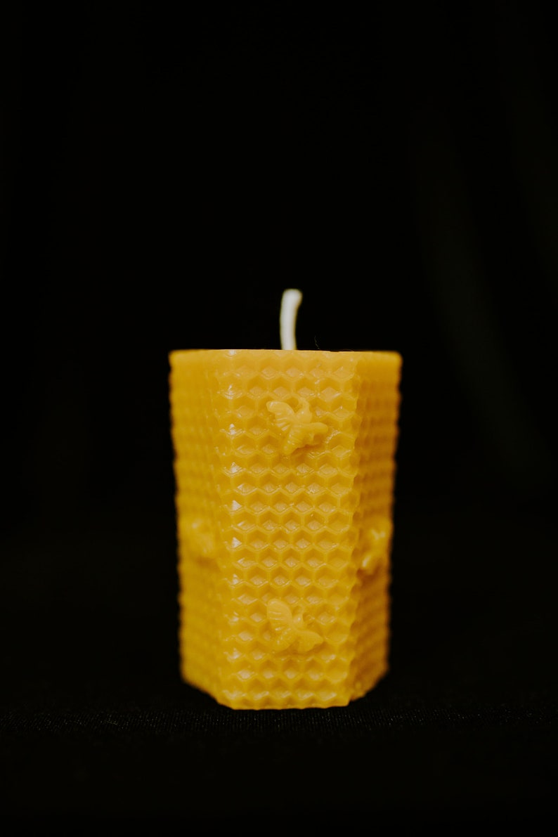 Hexagon Pure Beeswax Pillar Candle 2 in x 2 in x 3 in hex pillar candle with bee