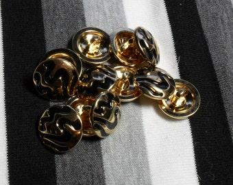 Black & gold round button. 1 button.