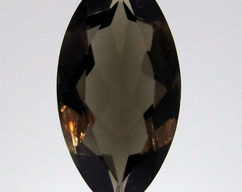 high quality                  068-009-003 27.85 carat faceted oval Smoky Quartz focal point bead