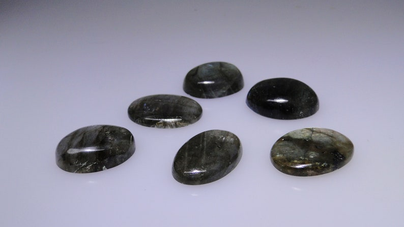 111.98 carats total      051-10-107 Group of six Labradorite oval cabochons