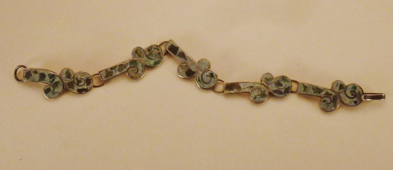 MEXICAN STERLING BRACEET  Taxco Signed 5 links Inlaid stones cutout floral design app 7 in long  58 in wide