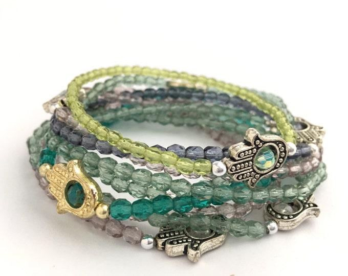 delicate tiny hamsa czech glass stretch beaded charm bracelet
