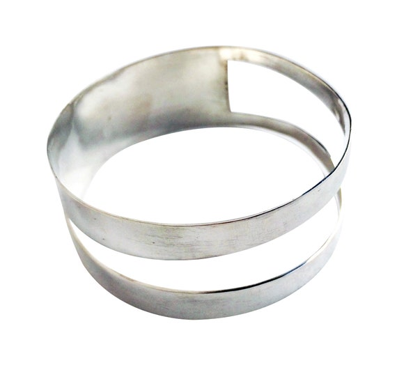 Wide geometric bangle bracelet