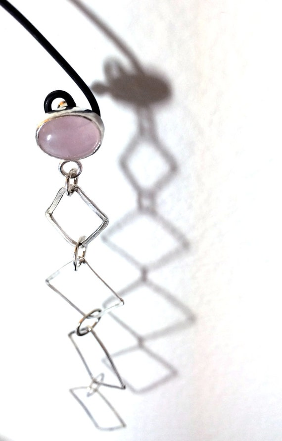 Long, lightweight, sterling silver dangle earring with rose quartz stud