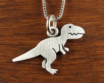 Tiny dinosaur pendant / necklace