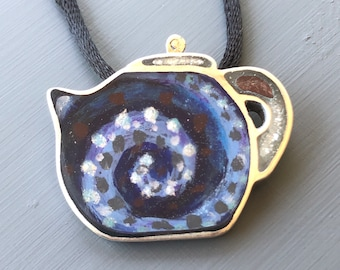Blue teapot necklace with spiral swirl