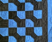 Amish Patchwork Bow Tie Quilt. 1930s. Blue and Black