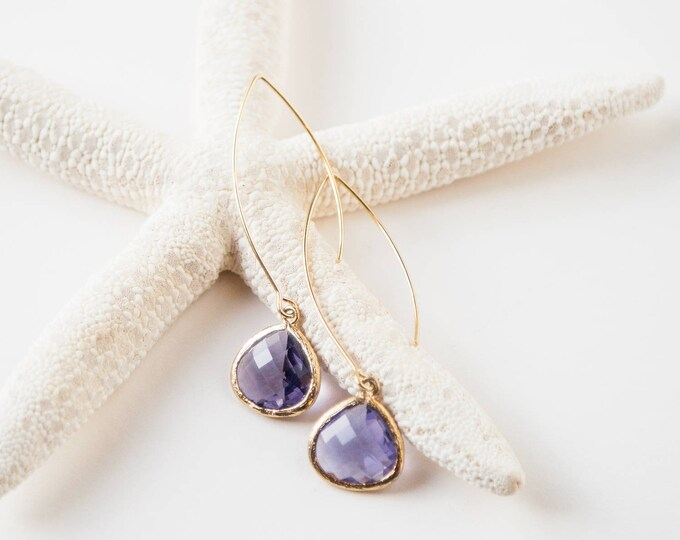 Gold earrings with purple glass