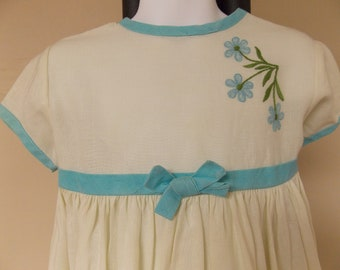 Vintage little girls dress, rayon or blend of, off white with blue trim/ties and embroidery, gathered waist, short sleeve S 5/6