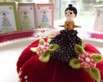 PINELOPE - A Wooden Doll Pin Topper with Two Itty Bitty Blossoms - Dressed in Black and White Polka Dots