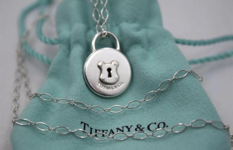 d738be82fe Tiffany & Co Sterling Silver Round Padlock Keyhole Pendant TC | Etsy