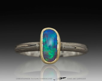 Mokume Gane Palladium, 14K Palladium White Gold, and Sterling Silver Ring with Oval Opal