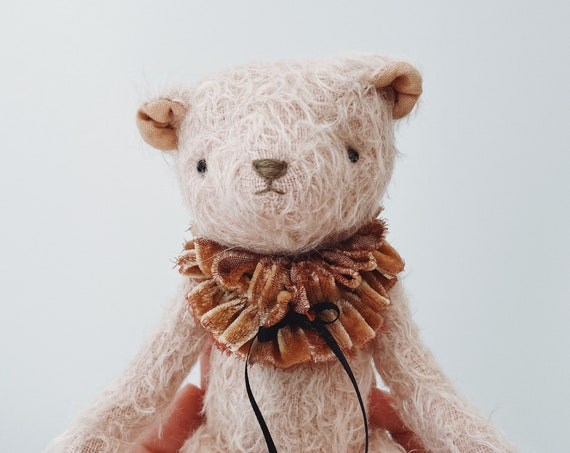 fuzzy pink jointed mohair bear with velvet collar
