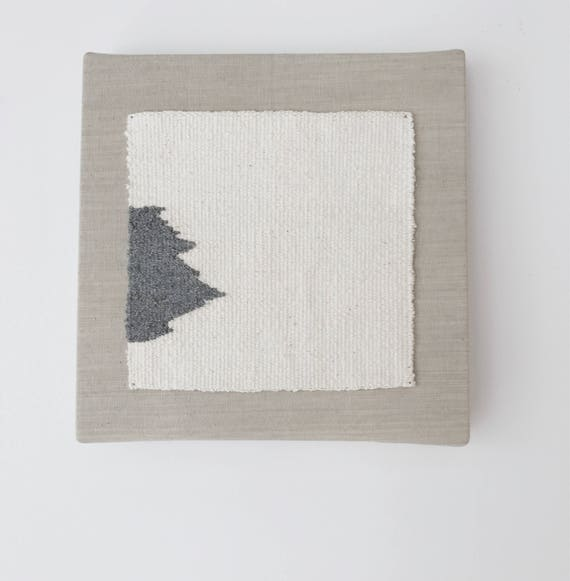 quiet and real   handwoven textile mounted on canvas