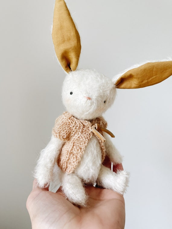 small jointed mohair bunny with cozy hand knit cardigan