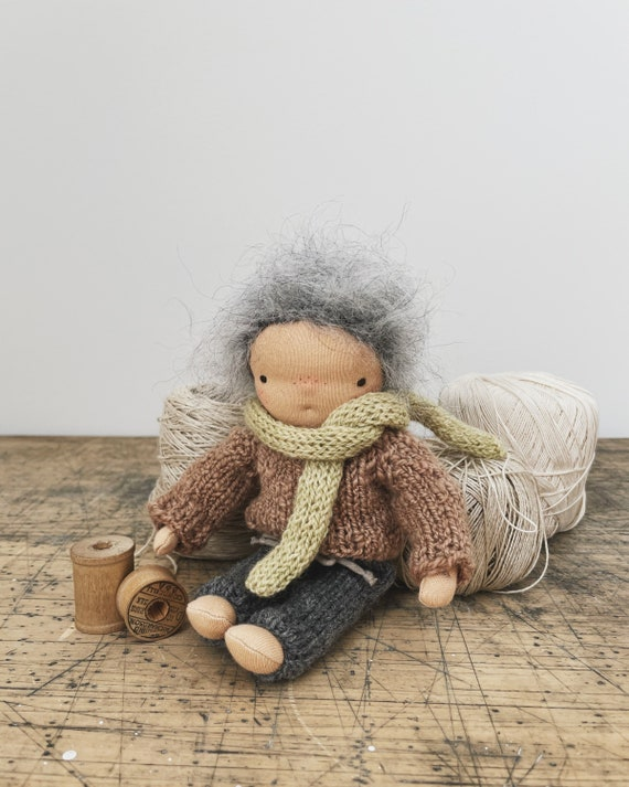 small waldorf doll in hand knit outfit