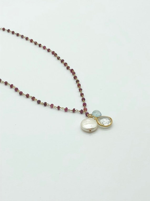 Garnet chain with blue topaz, pearl and quartz charms necklace