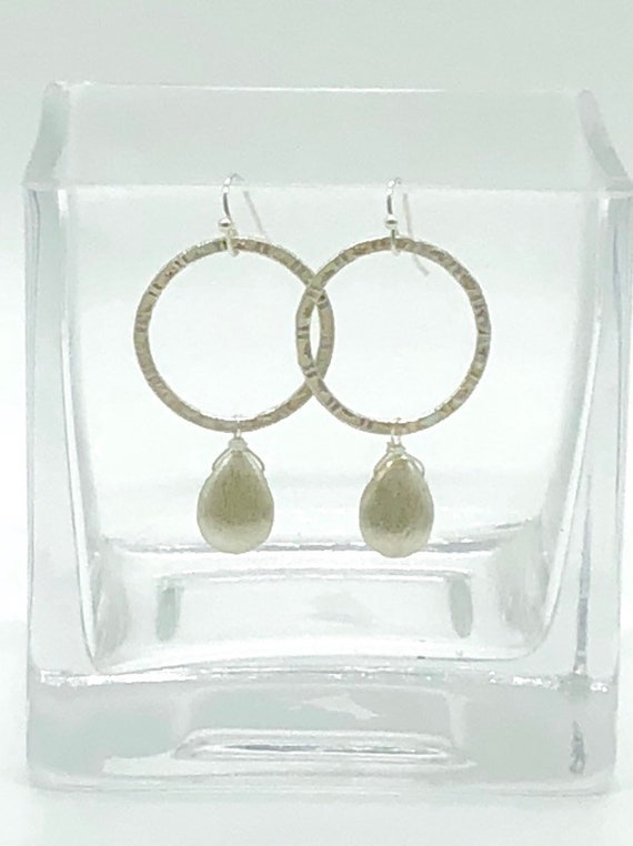 Hammered silver hoops with silver teardrop dangles.