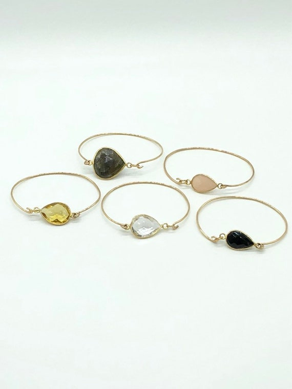 14kt gold filled bracelets with gold set stones.