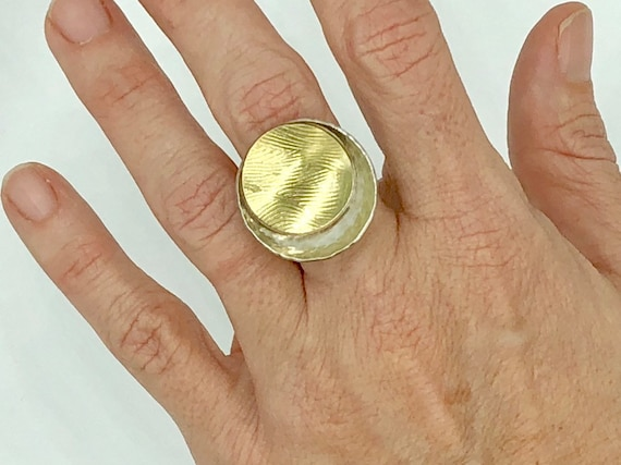 Textured gold and silver disc ring
