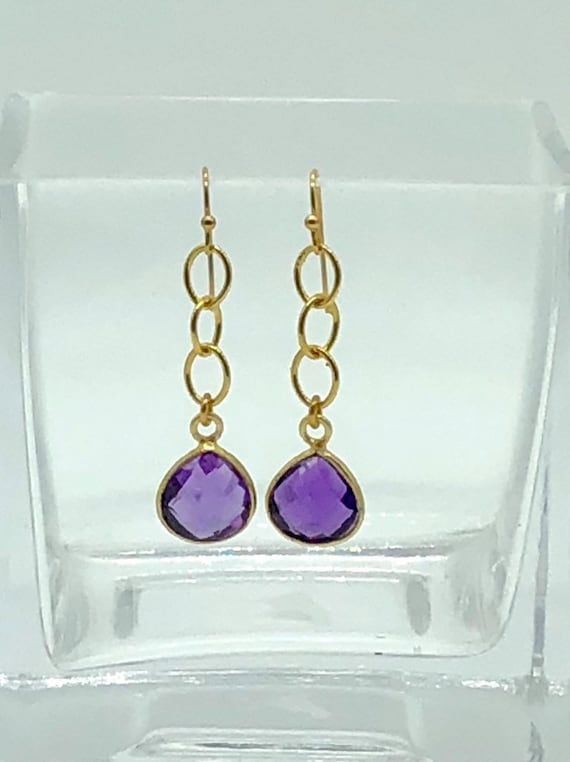 Gold chain with gold set amethyst teardrop earrings