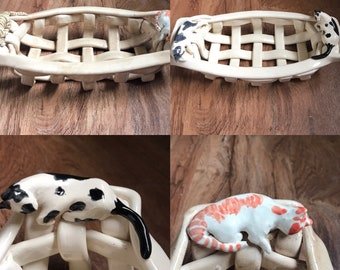 Woven ceramic basket with cats