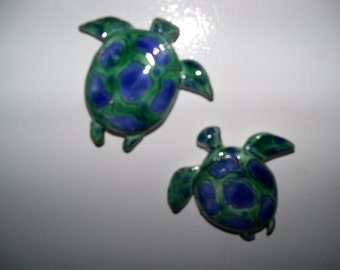 A pair of sea turtle magnets- pottery-blue green-kitchen-turtle