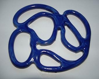 Free formed Cobalt blue ceramic trivet