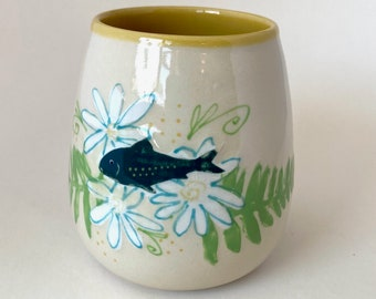 fish swims in flowers vase