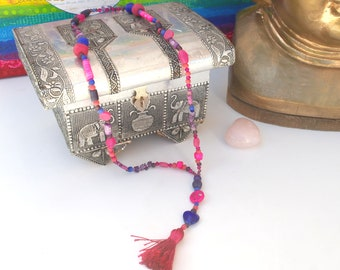 Hippy Treasure - A funky beaded necklace made from a spectrum of purple, pink and blue beads. Colourful Beads. Tassel Necklace.