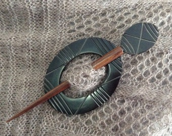 Black carved oval  with a bone and wood carved stick shawl pin reversible