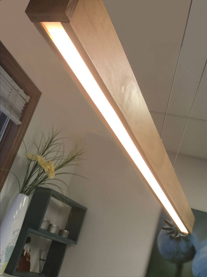 Linear led wood light fixture featuring rincon power hanging system