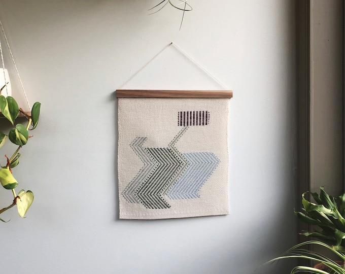 Teetering Woven Banner