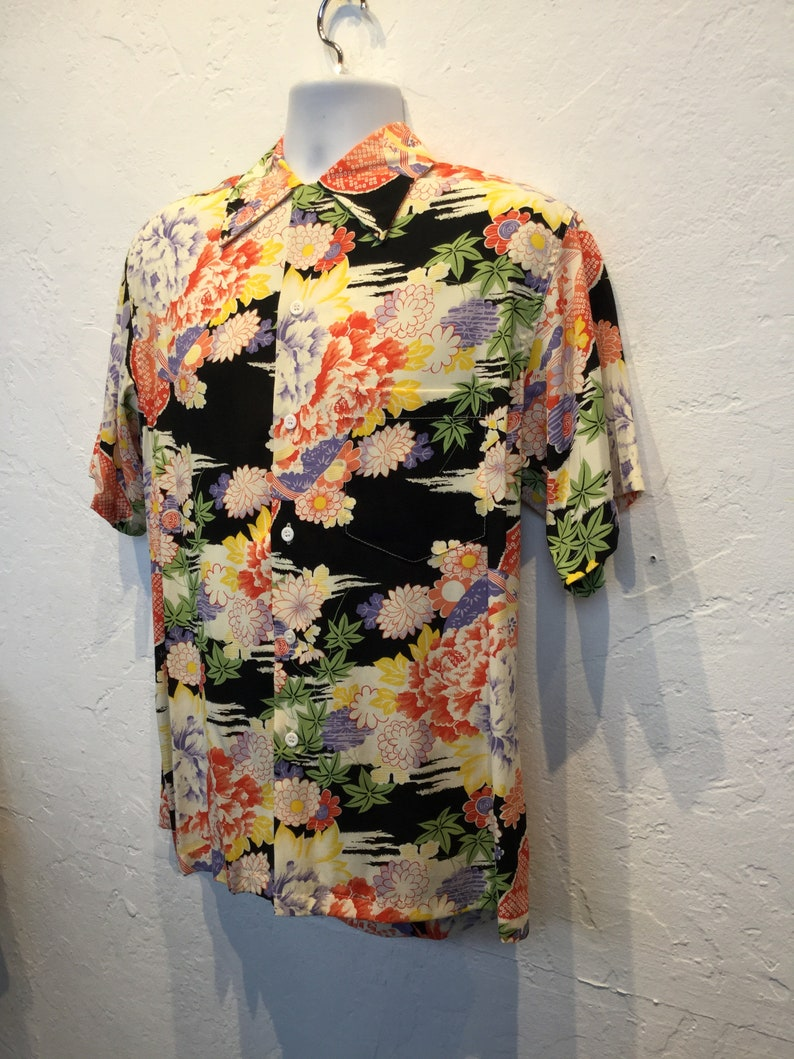 Vintage 1940s reproduction rayon Hawaiian shirt by Kon Bay Currently availabe in sizes medium.
