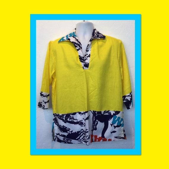 Vintage 1960s pullover tiki gaucho hawaiian shirt.