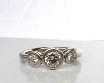 White gold bezel set women's 3 Stone ring, alternative engagement ring or ladies anniversary ring, ethical wedding ring