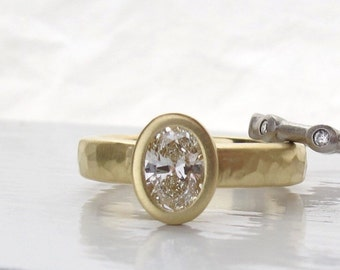 18kt recycled gold and oval bezel set diamond engagement ring with rustic hammered texture