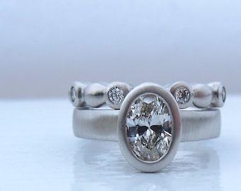 Platinum and oval diamond engagement ring, diamond eternity ring, women's diamond wedding band, GIA certified diamond