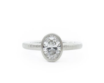 Oval diamond and platinum ring with slender bands, Oval Pacific Ring