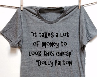 5c4eea7f0 It takes a lot of money to look this cheap. Dolly Parton quote. UNISEX.  Grey Heather tri blend super soft t- shirt. clothing. Dolly